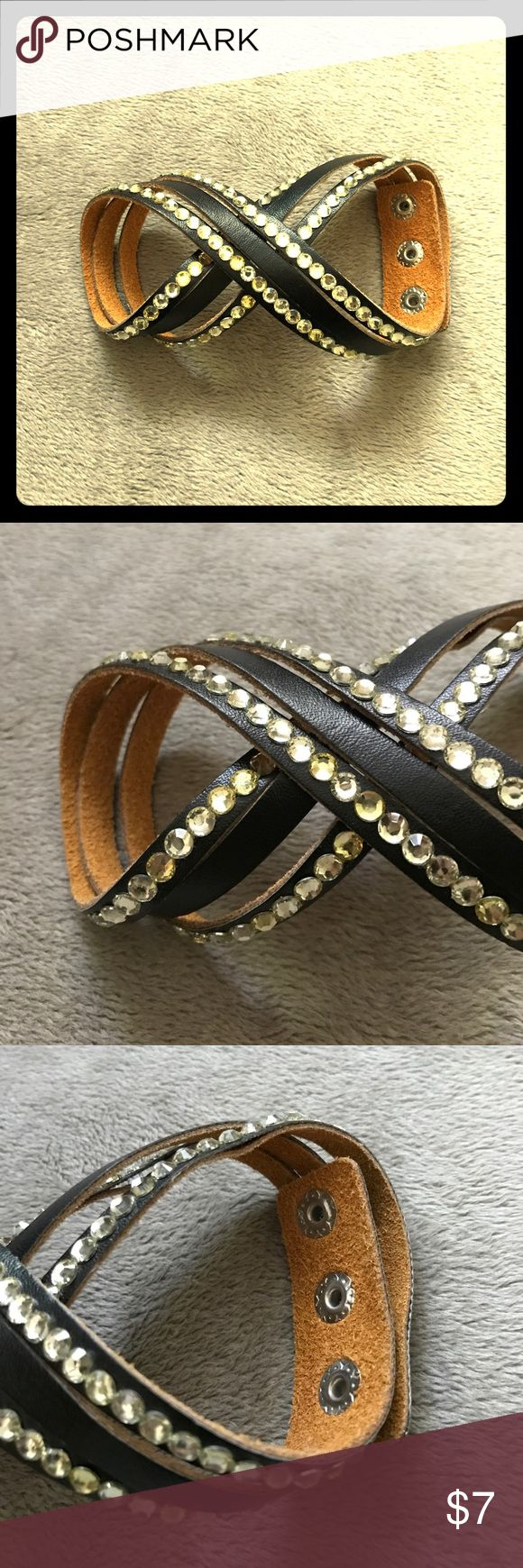 "NWOT Leather Wraparound Bracelet Never worn!  Has three snaps to adjust to your wrist.  Approximately 17"" in total length.  Price is firm unless bundled. Jewelry Bracelets"