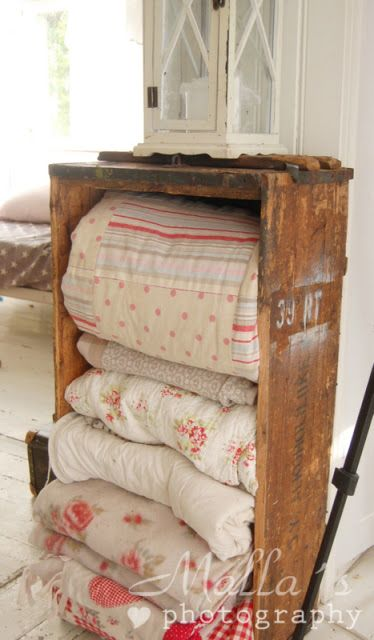 Old vintage quilts and linens in a old wood crate..bedroom decor + shabby chic + vintage + beachy + bungalow + country