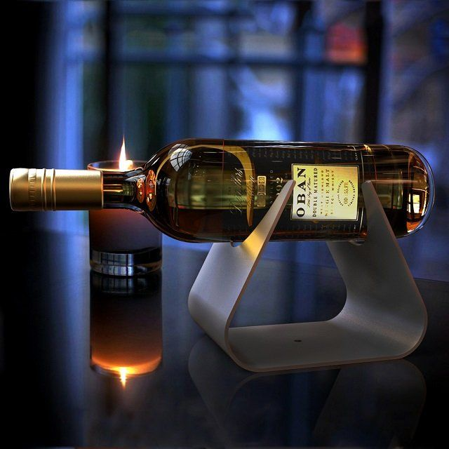 This strikingly clean-cut wine #holder from Decorpro comes in gunmetal-grey and will safely and securely hold your precious wine bottle until such time as you are ready to uncork it. - http://thegadgetflow.com/portfolio/vintages-wine-holder/