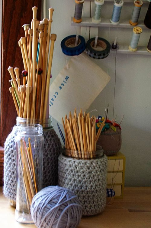 Three wonderful things: reuse for old spaghetti or applesauce jars, use for scrap yarn, and a pretty place for my rarely-used needles.