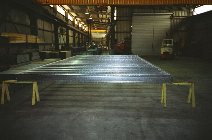 A steel floor frame chassis fabricated at our factory near Mittagong NSW for the Sydney 2000 Olympic Village.