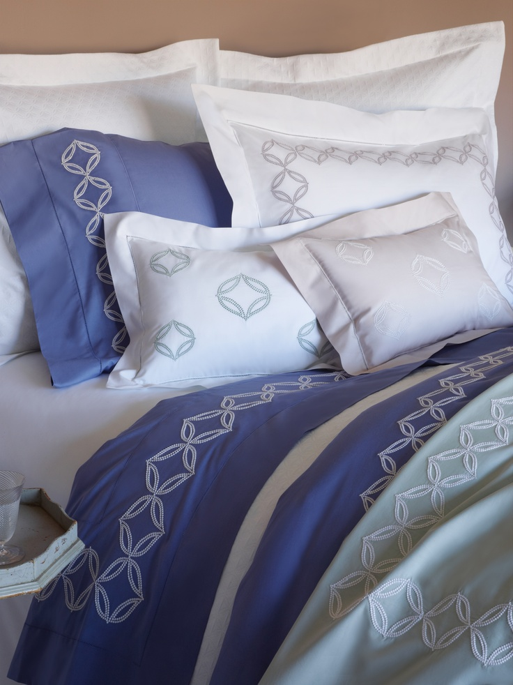 Cossa's color palette: SFERRA Egyptian cotton percale embroidery in Cornflower Blue, Lilac Ash, and Silver Sage.