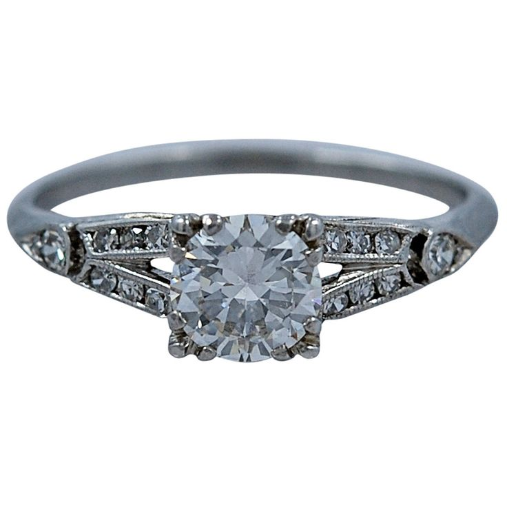 1930s Elegant Diamond Platinum Engagement Ring | From a unique collection of vintage engagement rings at https://www.1stdibs.com/jewelry/rings/engagement-rings/