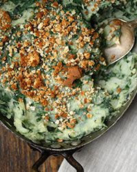 Healthy Potato and Spinach Casserole Recipe: A simple mix of vegetable stock and olive oil replaces the usual milk and butter in this lightened up mashed potato casserole. A little cooked spinach adds even more goodness. | Food & Wine