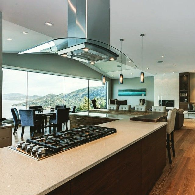 Great kitchens deserve a great view! #view #kitchen #kitchendesign #color #mountains #kelowna #BC #interiordesign #interiors #design #wood #granite #stone #island #hamlethomes #magpieinteriors #lakeview #house #home #beauty