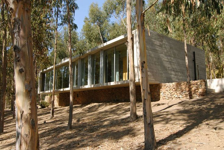 Large Windows, Stone Wall, Omnibus House in Cachagua, Chile by Gubbins Arquitectos
