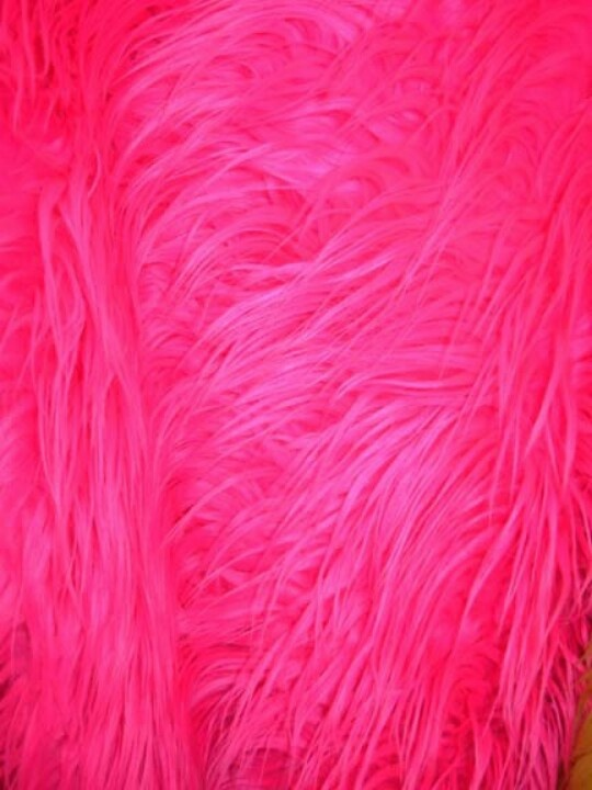 This pink fluffy rug will cover Bryleighs floor in her bed