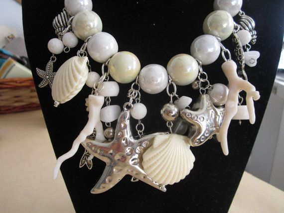 Collana girocollo con stelle marine e conchiglie di elisirdesign, €55.00