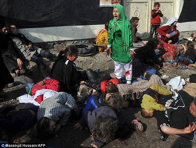 Jessica Hernandez- Pulitzer winning image representing the realities of a war. A girl is surrounded by lifeless bodies after a suicide attack.