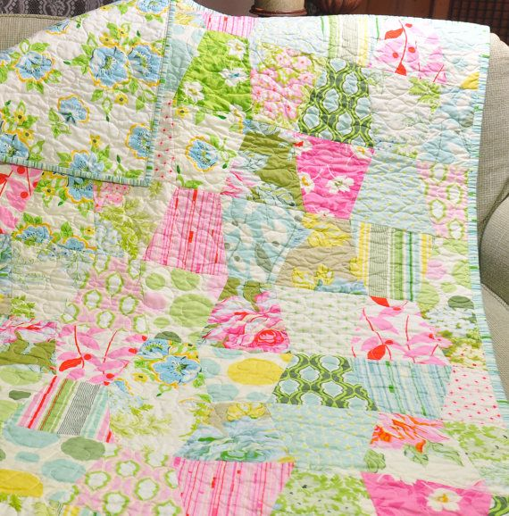 """Imagine wrapping up your little bundle of joy in this gorgeous baby girl's crib quilt blanket. Featuring fine fabrics from Heather Bailey's """"Nicey Jane"""" line, this unique and original quilt is the perfect blanket to keep your precious parcel warm on those chilly nights. The delightful pastel color palette is sure to beautifully accentuate baby's nursery marvelously. This makes a decadent gift for an expectant mother-to-be or even a seasoned mother. It also makes a bright and colorful photo…"""