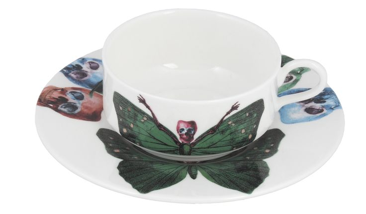 'Crudus' Mocha Cup & Saucer taken from the 'Lepidoptera' range designed by Maxim from The Prodigy. Based on imagery drawn from his wonderful paintings, this range features an array of unusual creatures. Butterfly design on cup continues onto saucer. Saucer also features edgy skulls taken from each six designs. Rear of mocha cup features a 22kt gold butterfly detail. Fine Bone China. Made in Stoke-on-Trent, England.