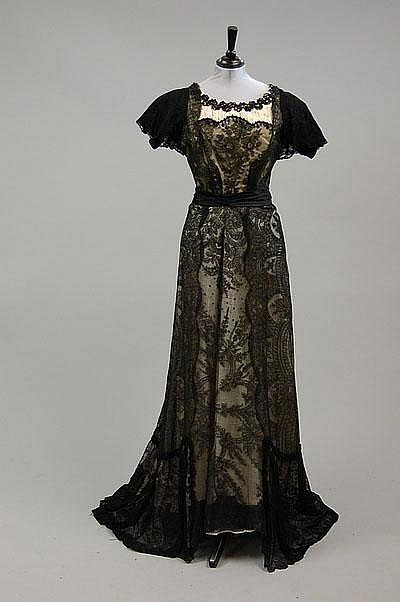 Three elaborate evening gowns, 1890-1900 and style, comprising yellow silk ball gown with black bead and lace overlay; black velvet gown with heavily beaded bodice; and ivory silk and black chantilly lace gown, (qty)