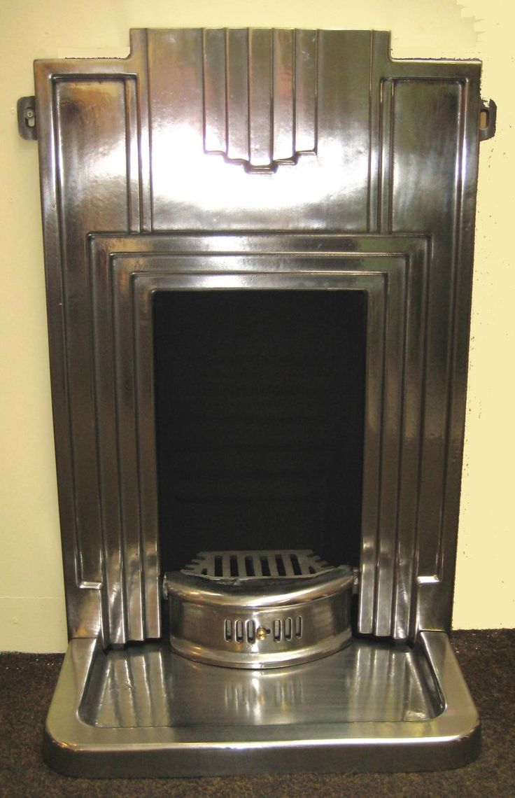 Art Decó fireplace surround.- will go great in my home theater with the old sconces that are of the same motif.