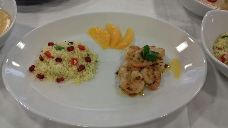 Rainbow couscous with Moroccan king prawns garnished with orange segements