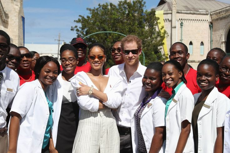 """From their near-matching white oxford shirts and cool shades, it looks like Prince Harry has fallen under the """"Rihanna effect."""""""