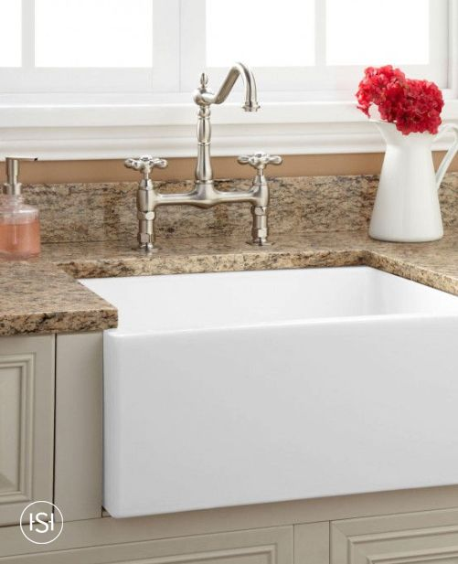 Grace your kitchen with the classic style of the Risinger Fireclay Farmhouse Kitchen Sink, which is crafted in Italy. A deep single well makes it ideal for washing and filling large cookware and other accessories.