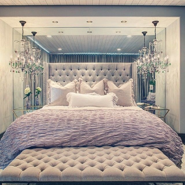 Tufted Headboard an bench at foot of bed adds character and drama to this Master Suite's décor