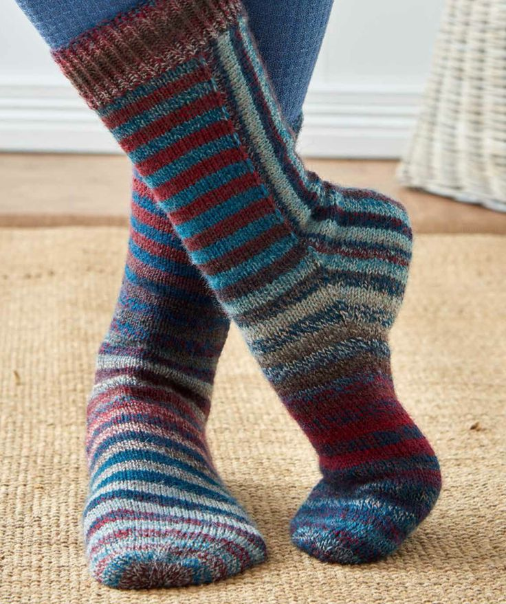 "Hogbuffer's design, ""U-Turn"" works the striped sock in pieces, from the cuff down, turns the heel, and works vertical stripes up the back of the leg without ever cutting the yarn or seaming."