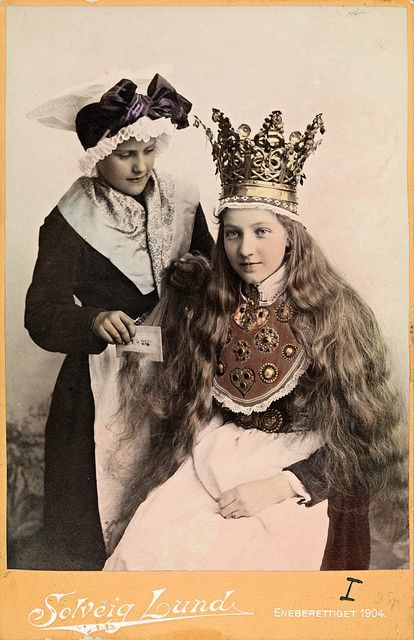 "Norwegian bride in bridal crown. (1904?) Norwegian proverb: ""In every women lives a queen... talk to the queen and she will answer."""