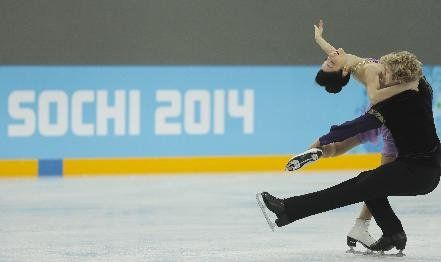 Meryl Davis and Charlie White of the United States skate at the figure skating practice rink ahead of the 2014 Winter Olympics, Wednesday, F...