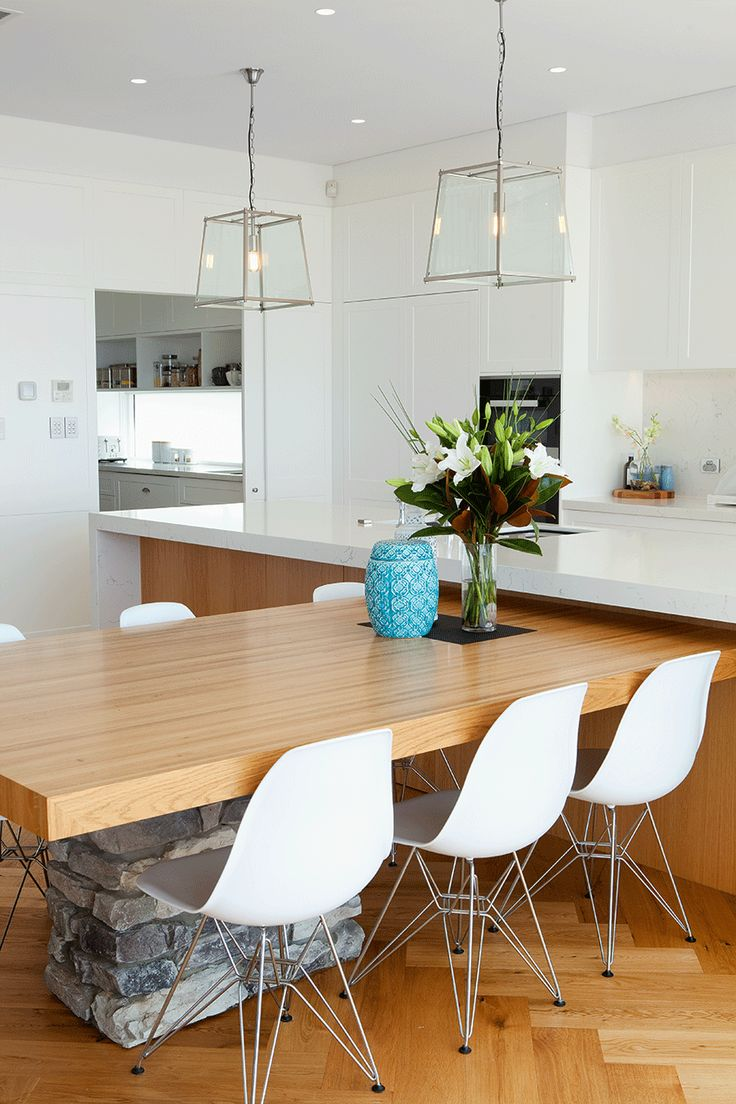 Where Old Meets New » Queensland Homes Blog | Classic white cabinetry and quartz bench top make this galley kitchen a timeless masterpiece. We also love the hint of exposed stone underneath the dining table - rustic and unique!
