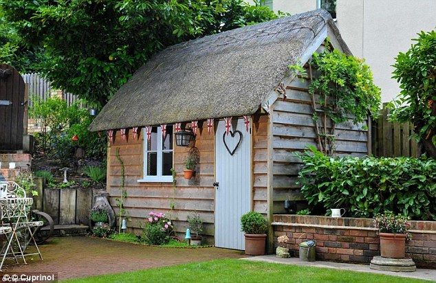 This she shed owner has gone for the Olde English Garden touch with their thatched rood and Union Jack bunting