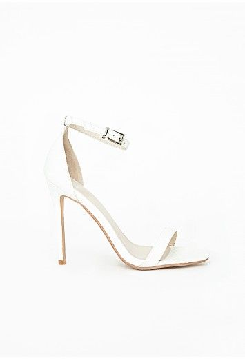 We're loving these hot white snake print pair teamed with a white dress for a fresh minimal look. Our Clara shoe is a style staple here at MG and will keep your feet looking better than the rest in the new season.   Buckle fastening  Fa...