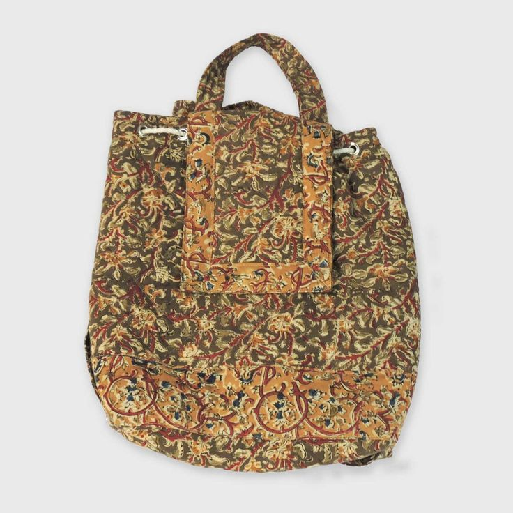 A fine crafted mini Kalamkari bag with a stylish quilted finish and a sleek look.