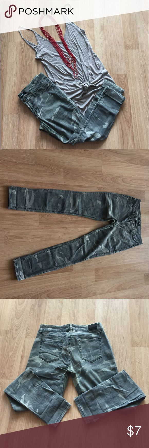 Camo skinny jeans. Camo skinny jeans with a more subtle toned pattern. 2% spandex so they have a little stretch, very comfortable! Wear with a plain tee or a button down and heels to dress it up! Rewash Pants Skinny