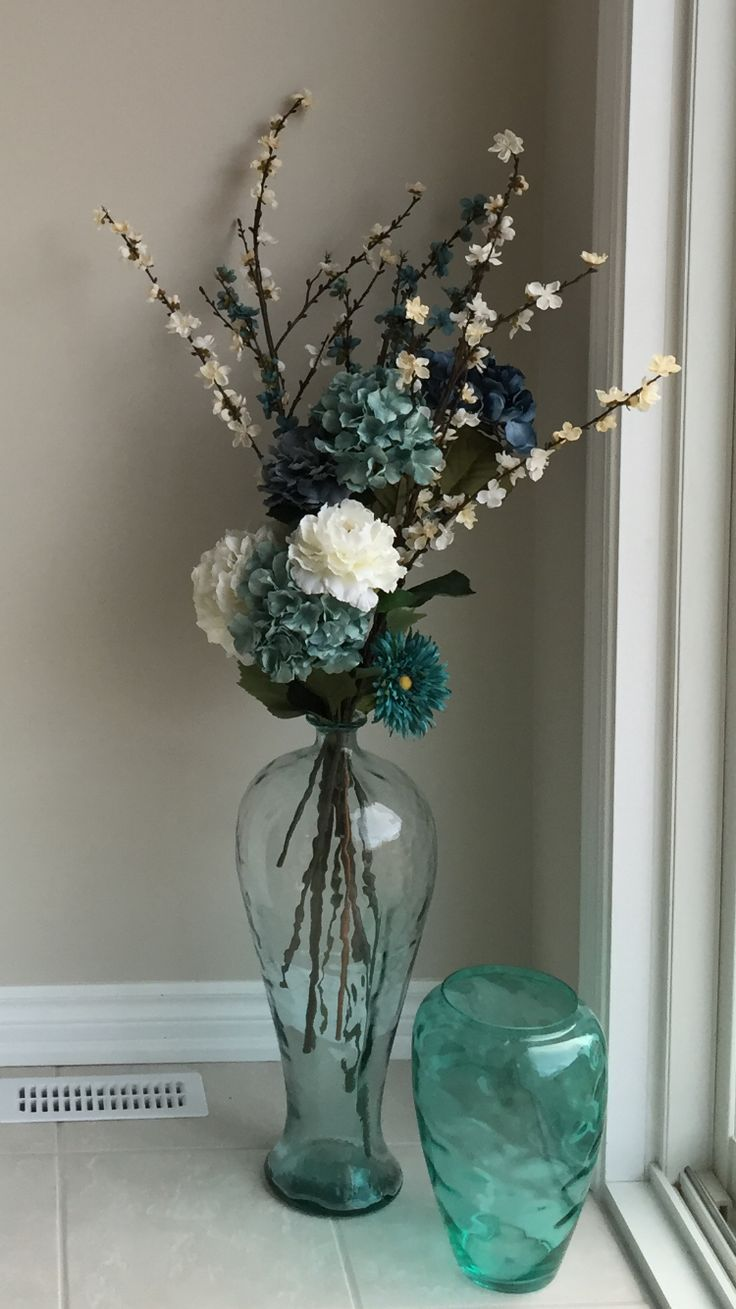 Sea glass floor vase with flowers.                                                                                                                                                     More