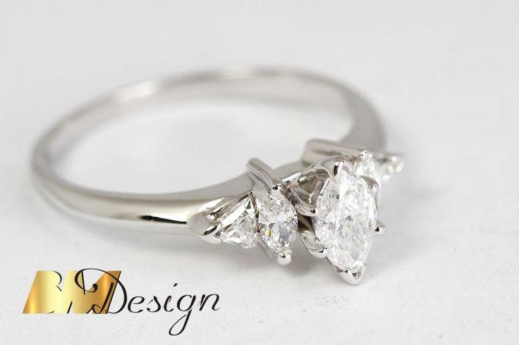 Piękny pierścionek z diamentami o szlifie markiza. Projekt i wykonanie BM Design. Idealny na zaręczyny i każdą inną okazję.