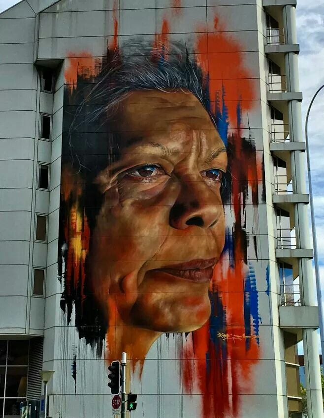 A portrait of aboriginal activist Jenny Munro in downtown Sydney by Adnate