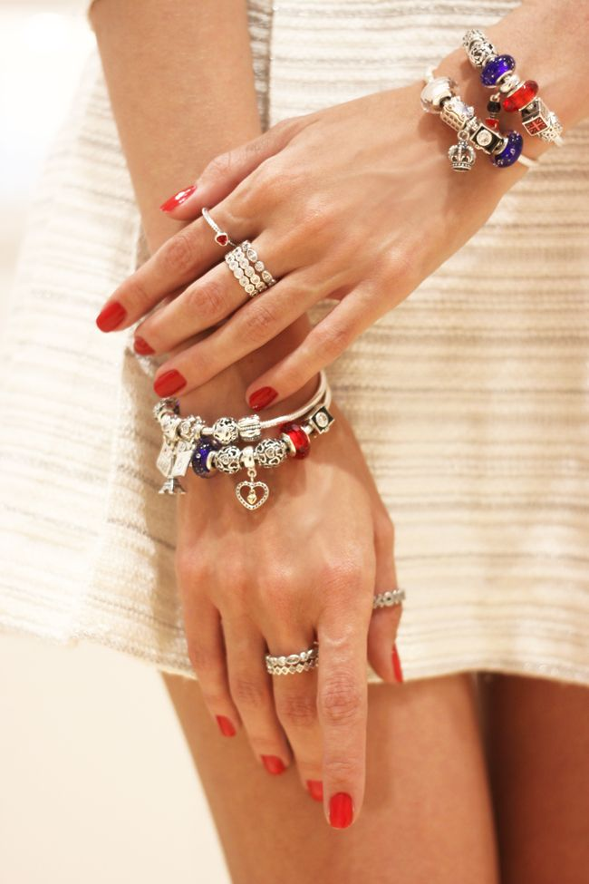 Red nails make the red color of the charms and ring pop. #PANDORAloves this photo by Brazilian blogger Flavia Desgranges of Fashion Coolture. #PANDORAbracelet #PANDORAring #PANDORAstyle