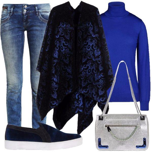 Questo inverno non possiamo farci mancare la magnifica mantella in velluto jacquard con scollatura profonda sui toni del blu, comoda per tutta la giornata dallufficio allo shopping. Abbiniamo il jeans a sigaretta ed il caldo dolcevita in lana merinos a collo alto, blu elettrico. Completiamo con la sneakers bassa senza lacci, in velluto blu e la borsa a spalla in pelle martellata, effetto laminato argento, con particolari richiami di blu.
