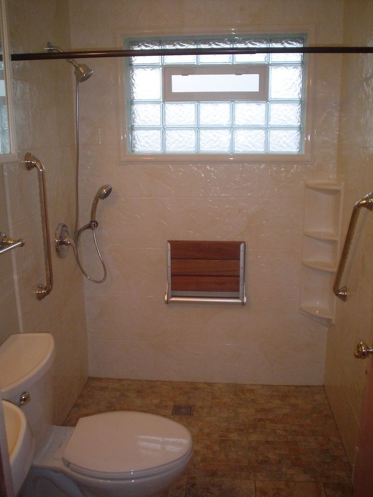 Best 25 roll in showers ideas on pinterest bathroom for Handicapped accessible bathroom designs