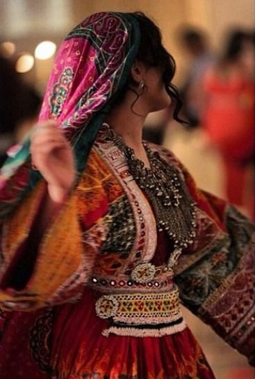 Afghanistan | Really beautiful beading and shape of dress, the colours and designs on fabric are very opulent, i really like how the fabric flows.