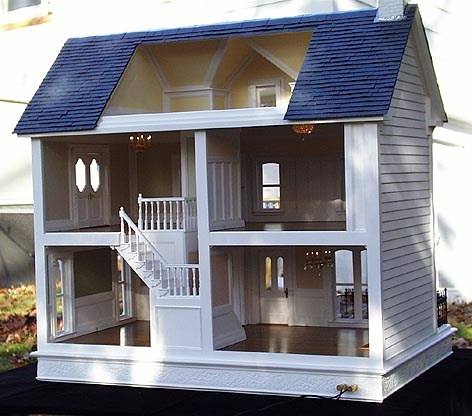 Love the way the stairs are on this dollhouse....Beautiful layout.