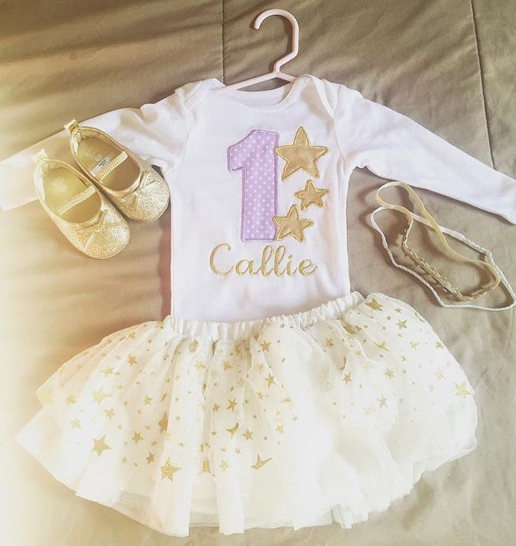 First birthday outfit ! Purple and gold, stars tutu with 1 and name embroidered onesie. Twinkle twinkle little star theme.      Onesie- HazelandEmma, Esty   Shoes & headbands- Oshkosh & Carter's   Tutu- Kardashian kids