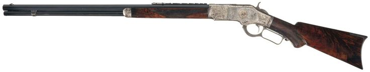 Factory engraved, gold and silver inlaid special order Winchester Model 1873 with seven leaf express sight.