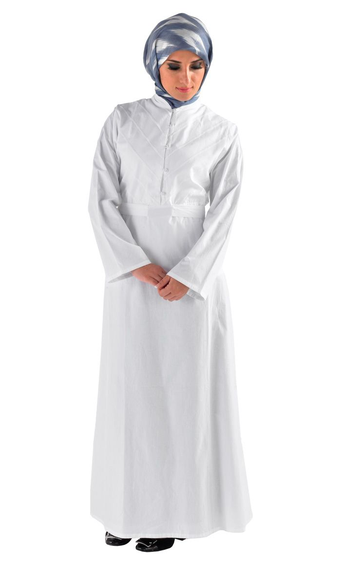 This white abaya is the quintessential feminine look great for Haj! Round neck line, buttons from neck to the waist,  A line skirt and high waist with a belt which provides a modest design with a contemporary look! The front top has intricate lines to give it a  distinction.  Fabric: Cotton twill, great for warm weather!