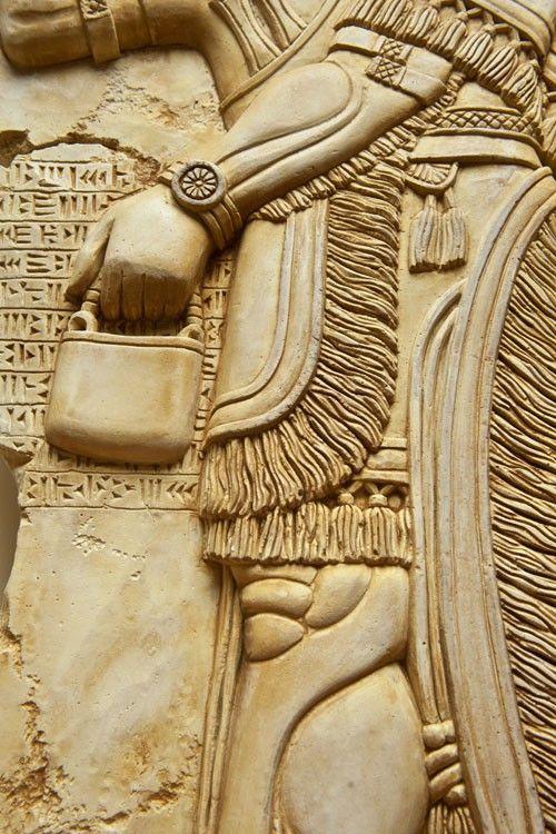 The art replica of an assyrian eagle-headed god Nisroch bas relief