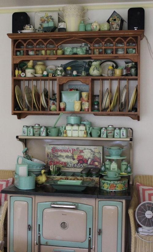 Gorgeous vintage stove with jadeite and plate rack
