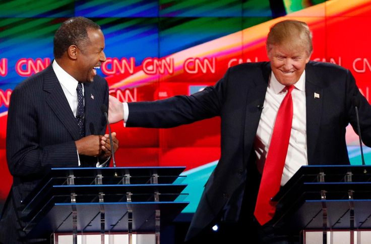 Republican U.S. presidential candidate businessman Donald Trump ® talks with Dr. Ben Carson (L) during a commercial break during the Republican presidential debate in Las Vegas, Nevada on Dec. 15, 2015. (REUTERS/Mike Blake/Files)
