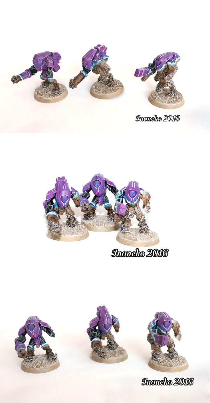 Violet Tau XV25 Stealthsuit during stealth transformation on rocky desert, Warhammer 40k