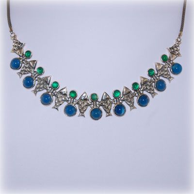 Fish necklace made of sterling silver with agate stones in blue and green. Entirely handmade in our workshop.