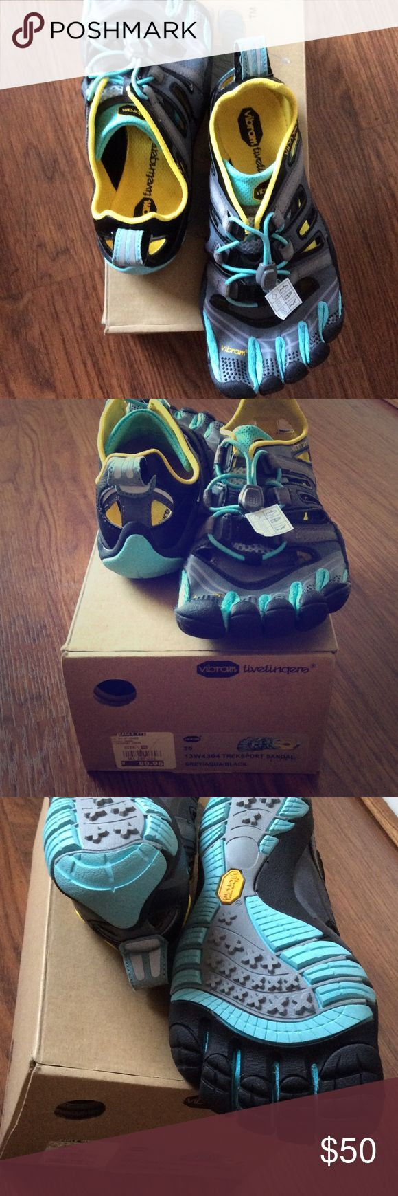 Vibram five fingers treksport Outdoor shoes with added grip with five fingers technology. Never worn, retail for $89.95 as shown on box. New in box. Grey/aqua/black. Smoke free, pet free home. Vibram Shoes Athletic Shoes