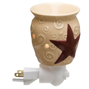 "Rustic Star Plug-In Scentsy Warmer (non-ETL)    An embossed, barn red star on a high-gloss tan base surrounded by whimsical scrolls say ""country"" wherever you place this cozy accent."