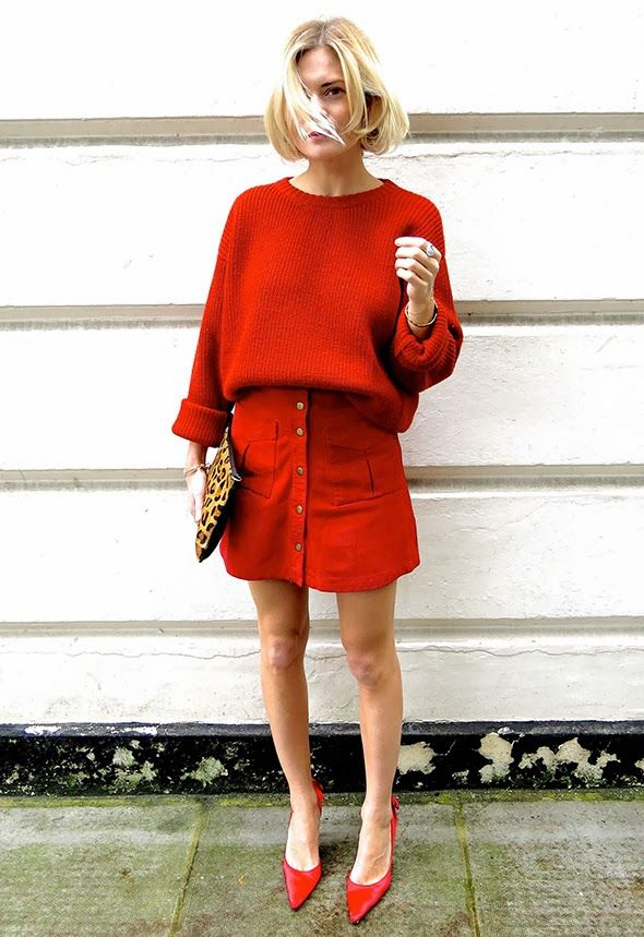 Pandora Sykes wearing red jumper, button-through skirt, red sling-back shoes, leopard clutch.