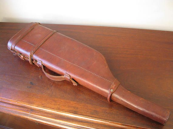 Superb Vintage Edwardian Style High Quality Saddle Leather Shotgun Leg Of Mutton Shotgun Case England A very nice vintage Edwardian style shotgun leg of mutton case in heavy saddle leather.  Of heavy saddle hide for field use with stitched leather seams. Brass buckle securing the lid and handle are strong and secure. The lid opens to traditional interior with the barrel compartment up to 30.  The leather is a beautiful deep brown colour and the construction is firm with other than age wear…