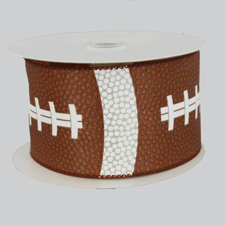"""2.5"""" football pigskin printed ribbon with wire edge. Versatile ribbon to use for birthdays, sporting events, homecoming, tailgating, etc Width: 2.5"""" Roll Length: 10 yards per roll (30 feet) Ribbon Edg"""